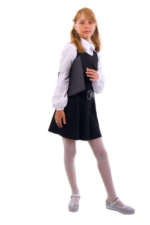 colegiala: Joven colegiala con una carpeta. Aislado en el fondo blanco. Foto de archivo