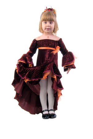 velvet dress: Little Princess. Studio Shoot Over White Background. Stock Photo
