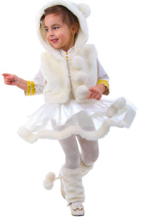 Dancing Young Girl In Fur Costume. Studio Shoot Over White Background. photo