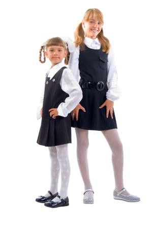 school uniform girl: Schoolgirls In Uniform. Studio Shoot Over White Background.