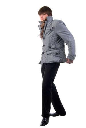 fashion shoot: Walking Adult Fashion Boy. Side View. Studio Shoot Over White Background. Stock Photo