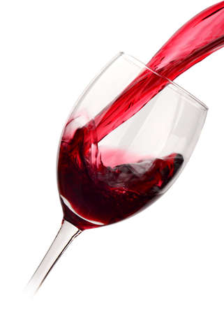 Red wine poured into glass isolated on white photo