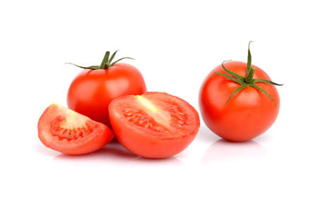 Few sliced red delicious tomatoes isolated on white Stock Photo