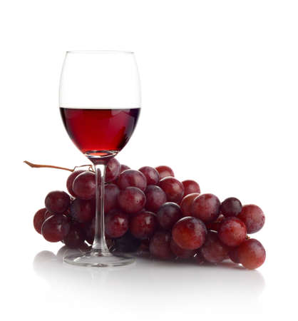 Red wine in glass and a bunch of grapes isolated on white