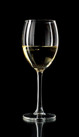 white wine glass: White wine in a glass on black background