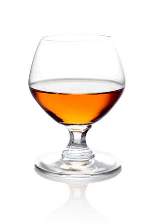 Studio shot of single glass of cognac isolated on white