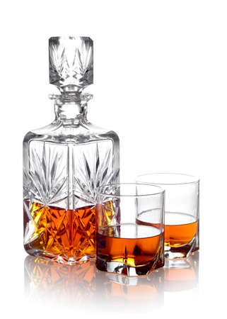 textspace: Studio shot of whisky in a carafe and two glasses isolated on white