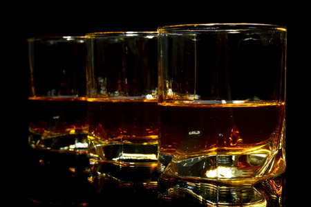 Studio shot of three glasses of whiskey