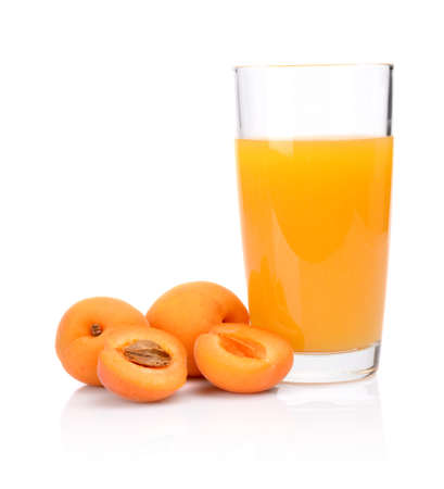 Studio shot of sliced orange apricot and apricot juice isolated on a white background photo