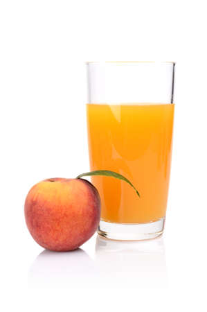 Studio shot of sliced orange peach with leaf and peaches juice isolated on a white background photo
