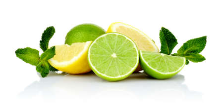 lemon lime:  Studio shot of three sliced lemons and limes with mint isolated on a white background