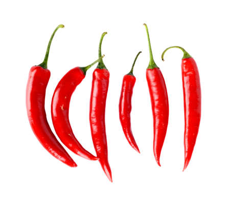 hot peppers: Top view of line composition chilli red peppers isolated on white background Stock Photo