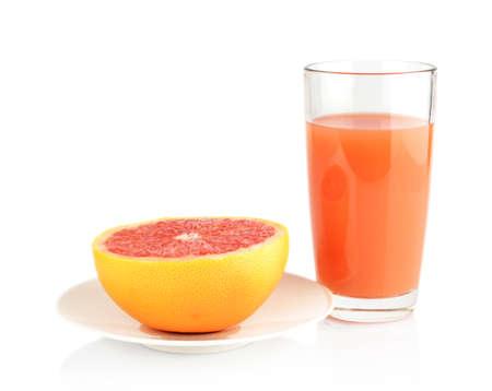 Studio shot of sliced grapefruit on plate with grapefruit juice isolated white background Stock Photo