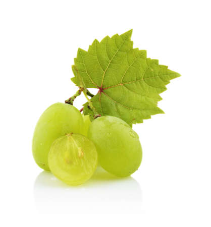 Studio shot some grapes with leaves isolated on white background photo