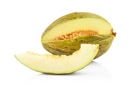 Studio shot of whole ripe melon piel de sapo with slice isolated on white background Stock Photo