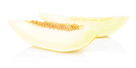 thou: Studio shot of slice of yellow canary melon isolated on white background