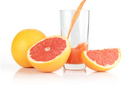 sliced grapefruits with grapefruit with poured juice isolated white background