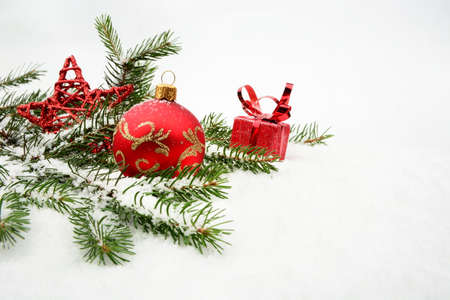 blithe: Decoration of red christmas gifts on snow with red star, christmas tree branch on white Stock Photo