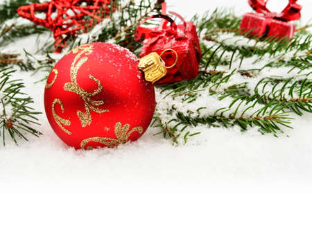 blithe: Close-up decoration of red christmas bauble with red gifts, star and twig of christmas tree Stock Photo