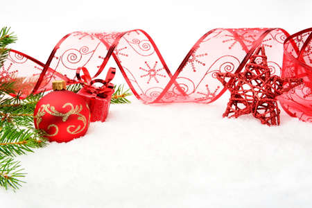 Decoration of red christmas on snow with red star, christmas tree branch on white Stock Photo