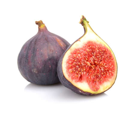two and a half: Two sliced figs lengthwise in half, isolated on white background Stock Photo