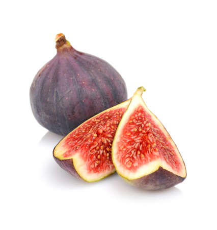 One whole fig and two quarters of figs isolated on white background Stock Photo