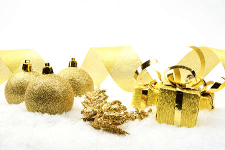 gewgaw: Decoration of golden christmas gifts,baubles,golden ribbon on snow