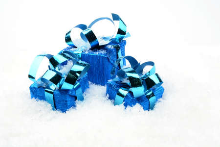 blithe: Decoration of blue christmas gifts on snow on white background