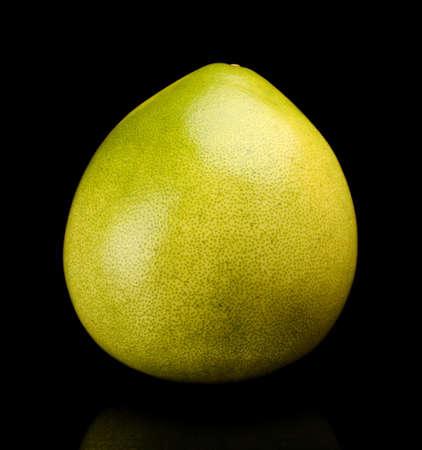 singular: Whole pomelo, chinese grapefruit isolated on black backgroun