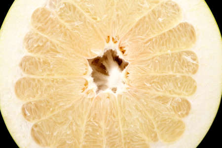 sectioned: Half of pomelo, chinese grapefruit isolated on black background Stock Photo