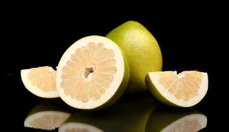 Four pomelos,half,quarter isolated on black background Stock Photo