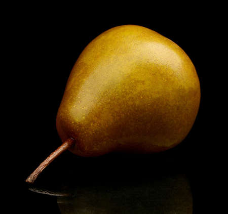 russet: Close-up photo of single,one pear called manon isolated on black background