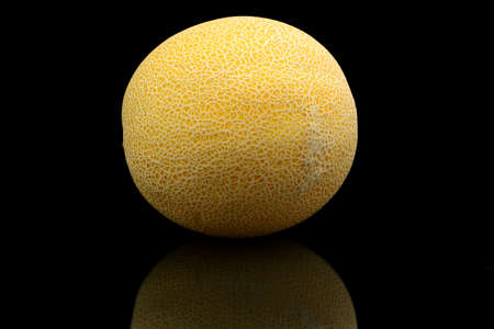 cancellated: Studio shot of whole ripe melon called galia isolated on black background