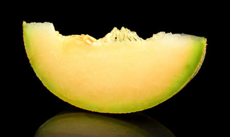 cancellated: Studio shot of slice,piece of melon galia isolated on black background Stock Photo