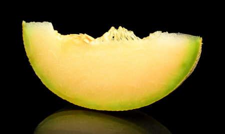 Studio shot of slice,piece of melon galia isolated on black background Stock Photo