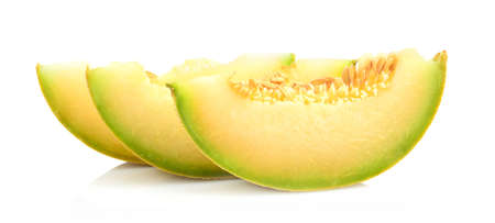 Studio shot of slices, pieces of melon galia isolated on white background