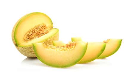 Studio shot of notched ripe melon galia with slices isolated on white background
