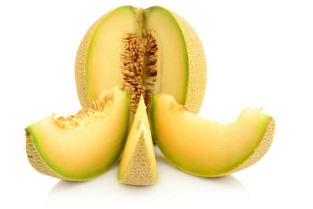 cancellous: Studio shot of notched ripe melon galia with slices isolated on white background
