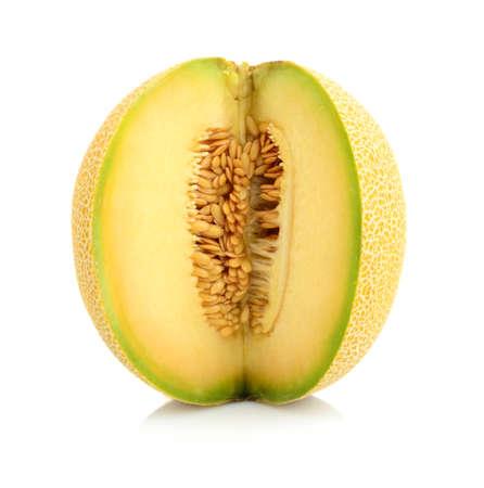 Studio shot of notched ripe melon galia isolated on white background
