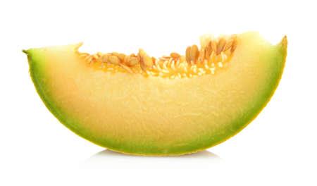 Studio shot of slice,piece of melon galia isolated on white background