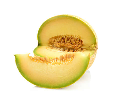 Studio shot of notched ripe melon galia with slice isolated on white background