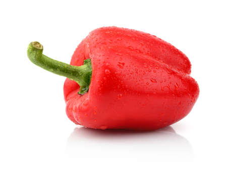 Single,one wet red pepper close-up with tail isolated on white background photo