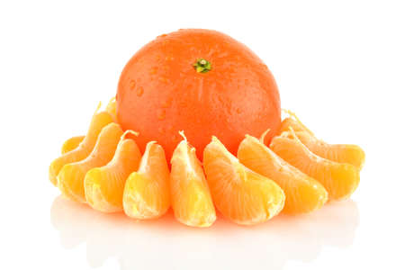 Studio shot pieces of dewy wet mandarine isolated on white background photo
