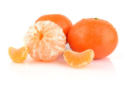 Studio shot dewy mandarines isolated on white background photo