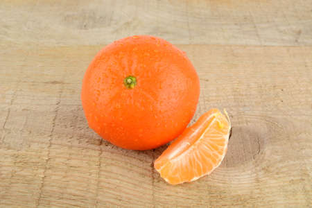 citrous: Studio shot mandarine, tangerine on wooden table on white with pieces Stock Photo