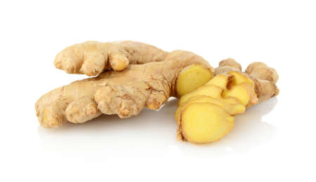 east asian ethnicity: Close-up shot of sliced ginger isolated on white background
