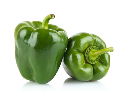Studio shot of green bell peppers isolated on white background