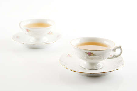oldstyle: Old-style porcelain two cups of tea on white background
