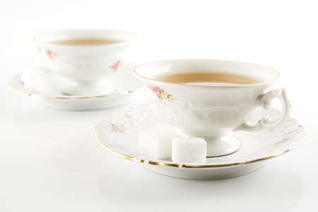 oldstyle: Old-style porcelain two cups of tea on white background retro style