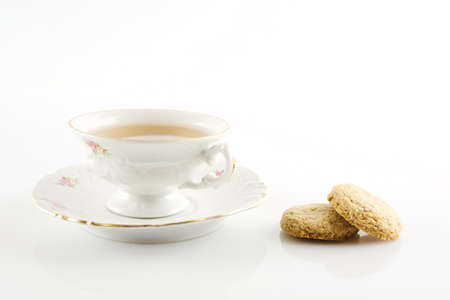 oldstyle: Old-style porcelain cups of tea with cookies on white background